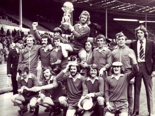 Morecambe players celebrate at Wembley with their FA Trophy in 1974.