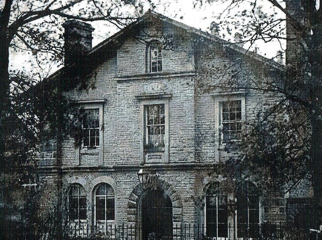 An early photograph of Victoria Hall in Settle (year unknown). Note the chimneys, ground -floor windows in place of the modern doors and the datestone over the door.