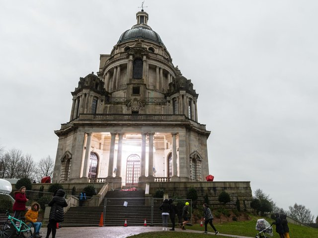 Passers-by brave the rain to check out the filming of Peaky Blinders in the Ashton Memorial. Photo by Kelvin Stuttard