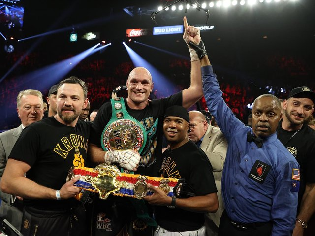 Tyson Fury (centre) after beating Deontay Wilder to win the WBC heavyweight crown