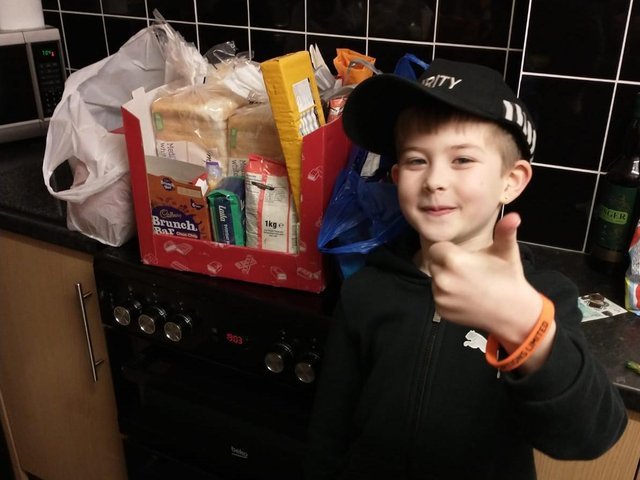Javier Shaw helping prepare food parcels for the lunch club.
