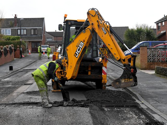 Preparations for surface dressing work to create a smoother, more weather-resistant surface (image: Neil Cross)