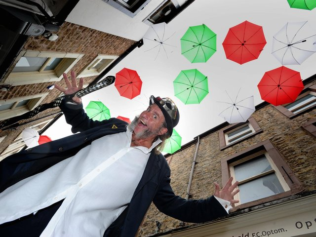 Lancaster first ever Italian Festival, Festa Italia, celebrated all things Italina from street food to Ferrari's all centred around City Museum and Market Square. One of the show compare's, Martin Houghton under the umbrella display. Picture by Paul Heyes, Sunday September 09, 2018.