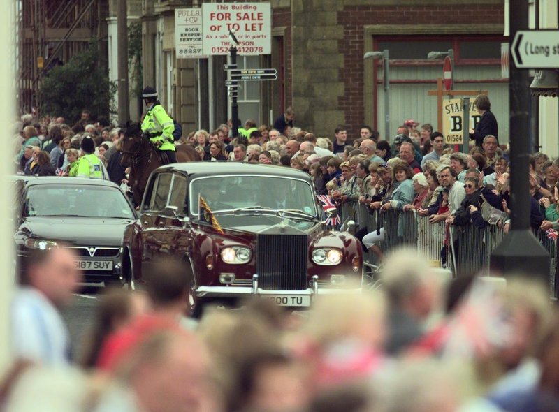 Crowds in Morecambe line the promenade to welcome The Queen and Prince Philip who were unveiling the Eric Morecambe statue in 1999.