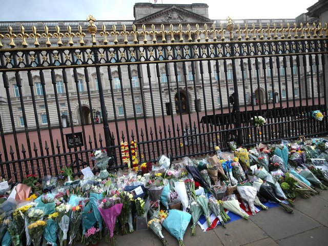 Floral tributes are left outside Buckingham Palace, following the announcement of the death of the Duke of Edinburgh at the age of 99. Picture date: Friday April 9, 2021. Picture: PA Wire/PA Images/Yui Mok