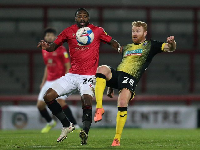 Yann Songo'o scored Morecambe's second goal at Grimsby Town