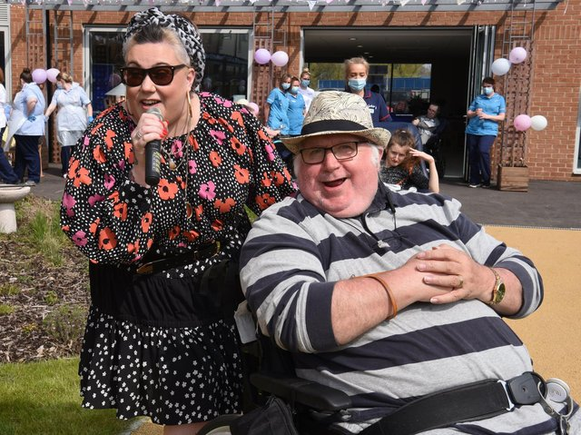 Singer Dani Wallace and her dad Danny Gallagher, a Sue Ryder centre resident, were reunited at the birthday party                  Photo: Neil Cross