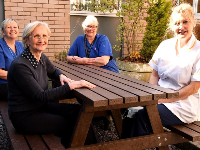Dental nurse Julie Atkin, receptionist Hilary Freedman, dental nurse Anne Hughes and senior dental nurse Cecily Pike are pictured enjoying the new outdoor furniture at the Maxillofacial Department at Royal Lancaster Infirmary.