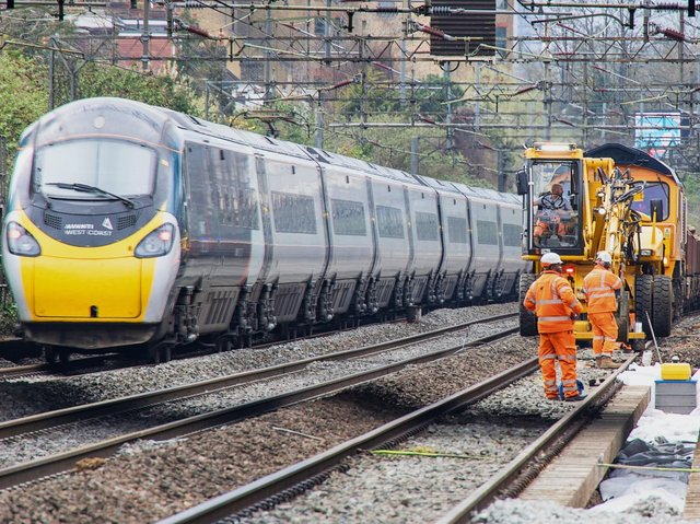 A train passes engineering work on the West Coast main line. Rail passengers are being warned of disruption on the line this May bank holiday weekend. Picture courtesy Network Rail