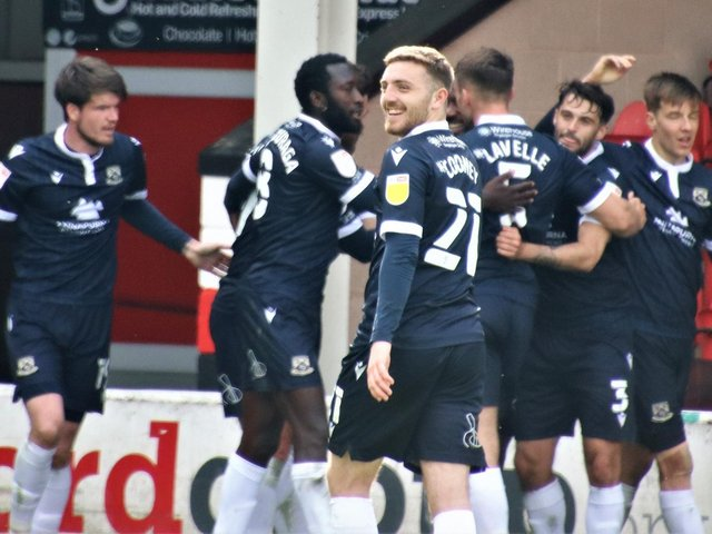 Morecambe maintained their automatic promotion hopes with victory at Walsall