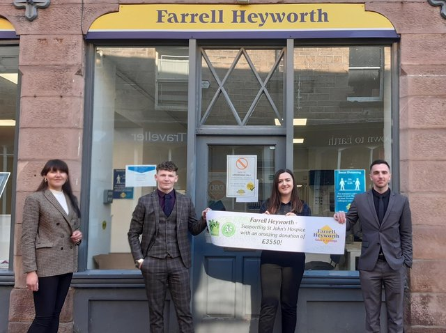 The staff of Farrell Heyworth Lettings Office in Lancaster with their thank you banner from St John's Hospice.
