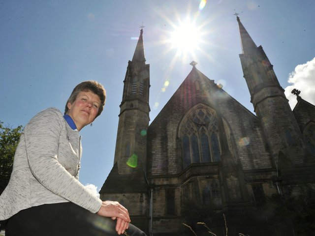 Revd Susan Seed pictured at Christ Church, Lancaster, showing the bell tower. Revd Susan is doing a zipwire challenge to raise church funds and funds for the Lancaster Friends of Chernobyl Children's (FOCC) group.