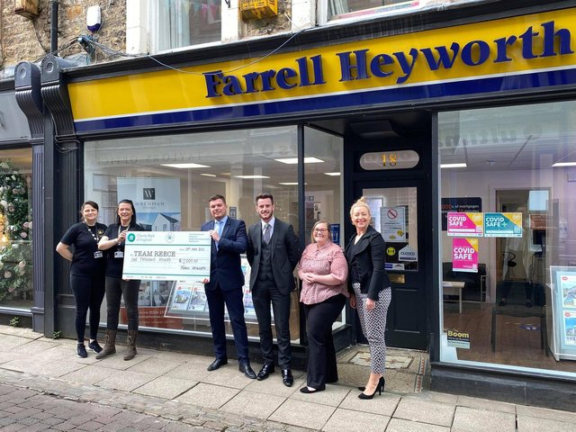 The team at Farrell Heyworth hand over the cheque to Rachel O'Neil (second left).
