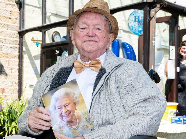Tom Hanley with his birthday card from the Queen.