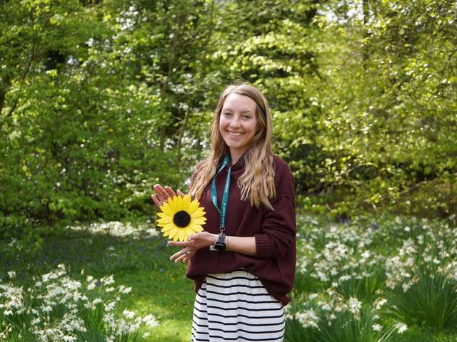 Natalie Santamera with a sample sunflower.