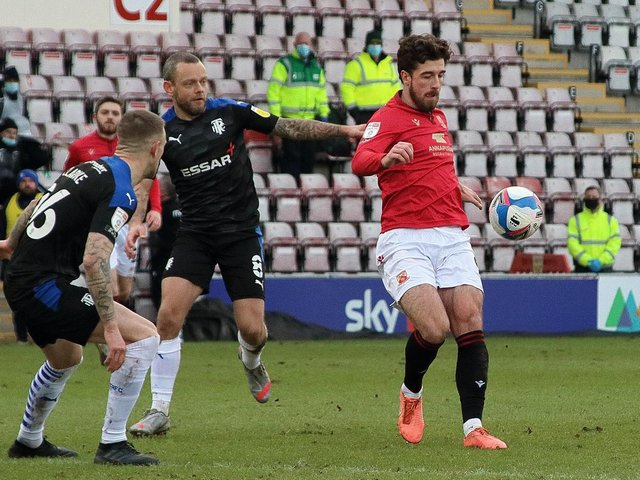 Jay Spearing (challenging Cole Stockton) has had his say on Morecambe's play-off semi-final with Tranmere Rovers