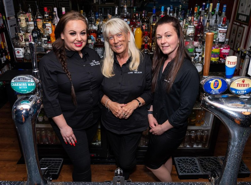 Caitlin Povey, Teresa Winward, and Rayanne Stockton working at The Lord Nelson.