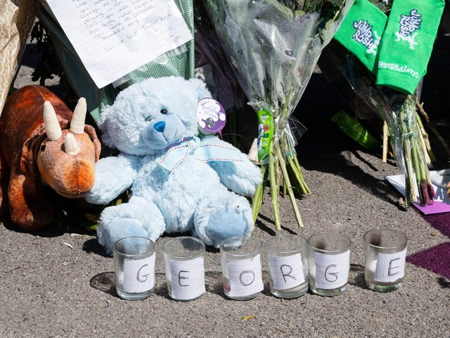 Tributes to two-year-old George at the scene.