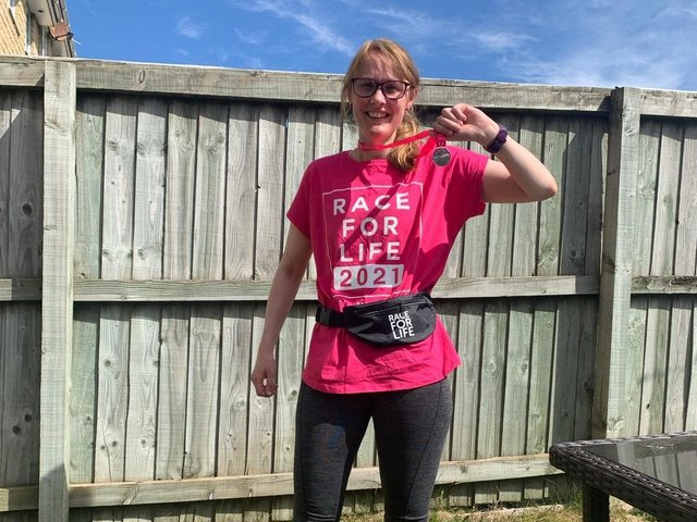 Cat Smith after running 5K and raising money in Race for Life, the first ever run she has taken part in.