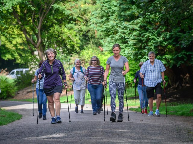 A group of U3A members take part in a Nordic walking event.