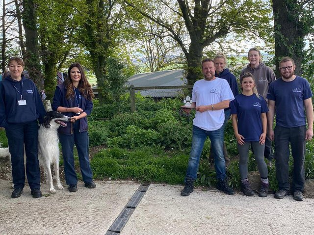 Sarah Hayland and Sarah Jones from Lancaster City Council's dog warden and animal licensing team presenting the award (socially distanced) to the team from Wolfwood Wildlife and Dog Rescue.