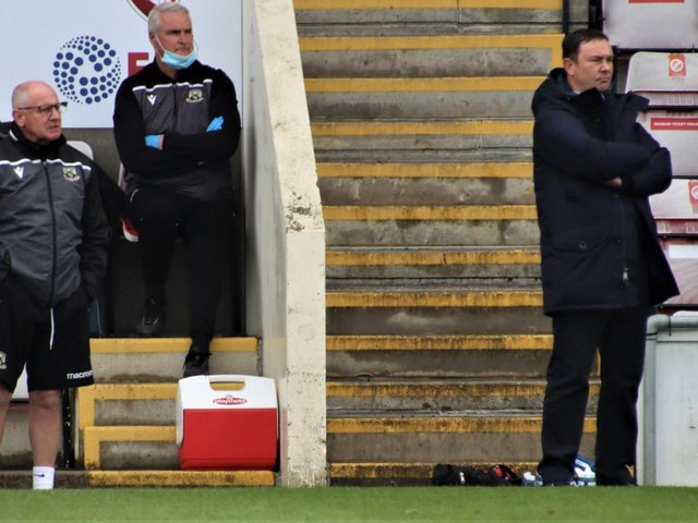 Derek Adams and his assistant, John McMahon, have Morecambe within one victory of a place in League One