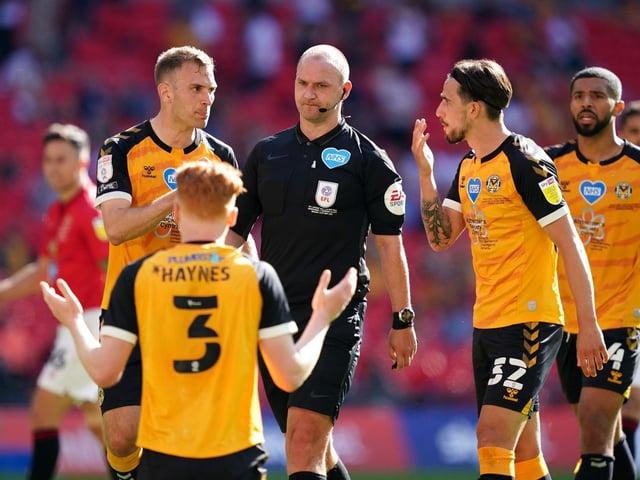 Bobby Madley awards Morecambe's penalty.