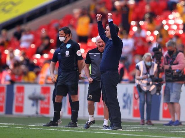 Derek Adams celebrates promotion as the final whistle sounds at Wembley