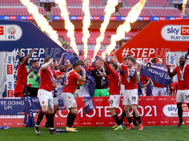 Morecambe celebrate League Two promotion play-off final victory on Monday