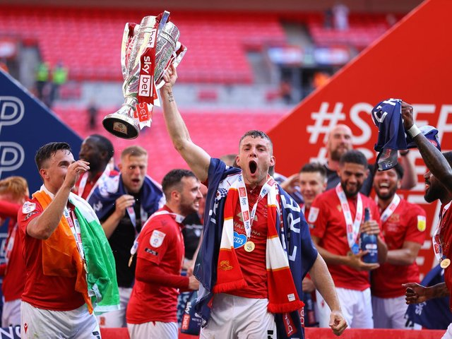 Sam Lavelle skippered Morecambe to victory at Wembley