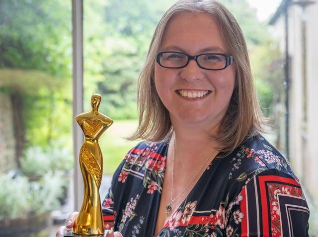 Jennifer Grabowski, Managing Partner at Oglethorpe Sturton & Gillibrand, with her Women in Law Award.