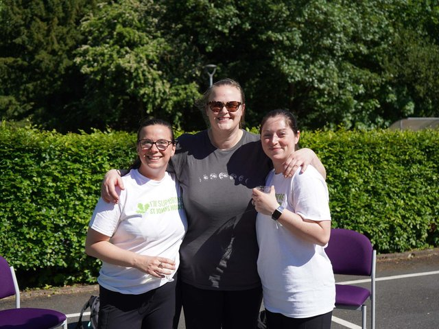 Celebrating the end of their walk are, from left, Jen, Luise and Nicola.