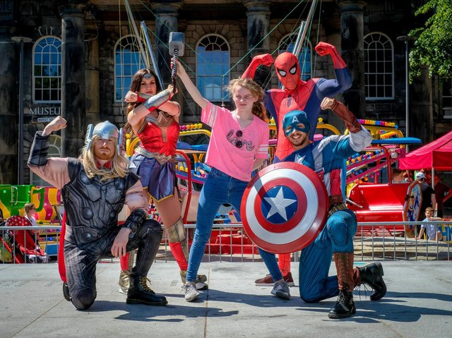 Lancaster Superhero event in Market Square. Anya McGinn of Lancaster joins in the fun. Picture by Martin Bostock.