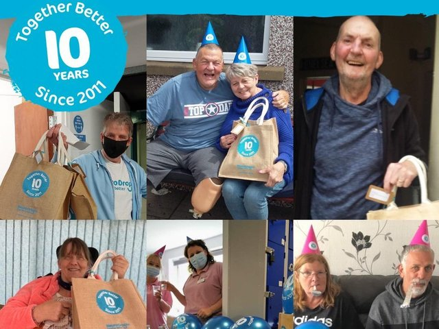Some of the Neuro Drop In's members get ready to celebrate 10 years of the charity.