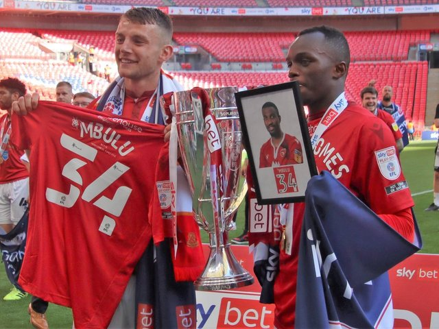 Sam Lavelle and Carlos Mendes Gomes pay tribute to Christian Mbulu after victory at Wembley