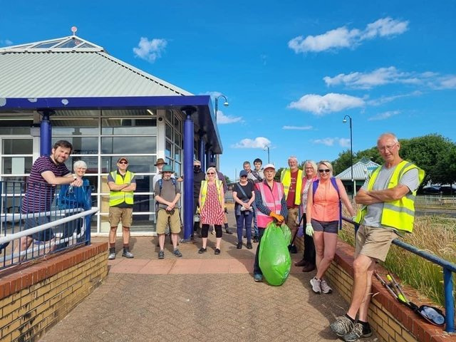Coun Charlie Edwards (left) with other councillors and volunteers during the Morecambe tidy-up on Friday.