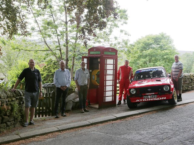 Pictured (from left) Mark Hothersall, Parish Councillors John Drinkall and Mark Atkinson, rally driver Darren Atkinson, and Parish Councillor Barry Pye by the new defibrillator          Photo: www.pro-rally.co.uk