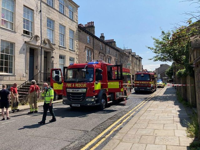 Firefighters and paramedics at the scene in Queen Street. (Photo by Joshua Brandwood)