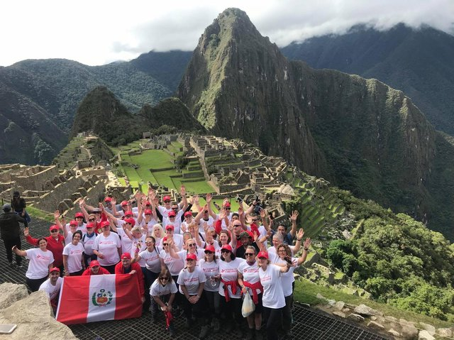 The Peru trekkers arrive at Machu Picchu in 2018. Debbie is front row, fourth from right.