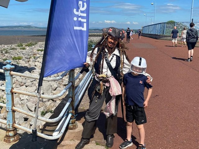 Henry with Captain Jack Sparrow during his bike ride in Morecambe. Photo credit: Keith Sargeant