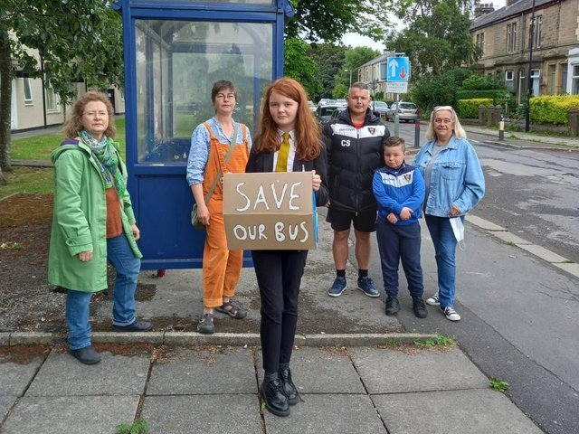 Concerned parents, pupils and councillors gather to protest againt the bus service cut