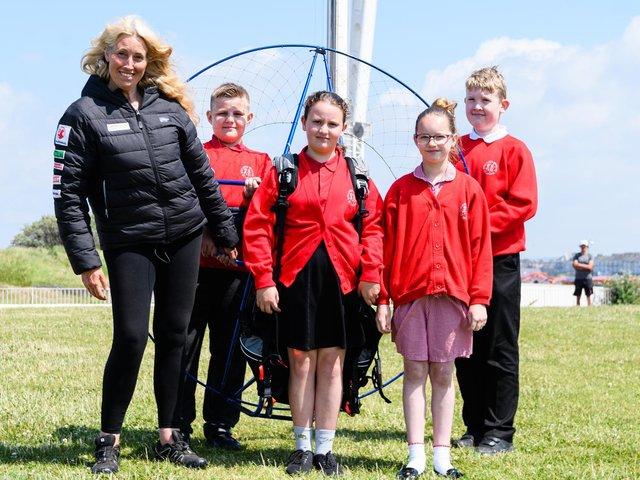 Sacha Dench the Human Swan with year five pupils from Rylands Primary School and the paramotor (l-r) Leon Lowther, Lillie Rose Watt, Destiny Louis, Jacob Pinder. Photo: Kelvin Stuttard