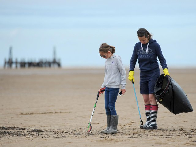 Litter pickers on St Annes beach.  Dawn Chapman with daughter Sophia Mason, 9.