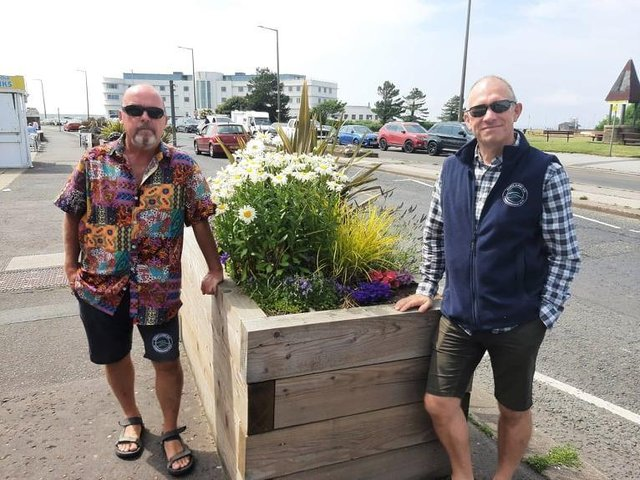 John O'Neill, Morecambe BID manager, and Tom Powney, Morecambe BID chairman, with one of the planters which has been funded by the BID.