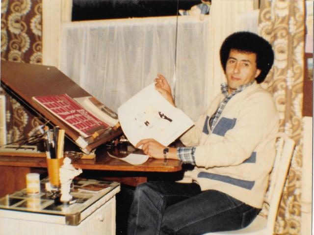 Satirist at work - at his desk in Burnley (1980)