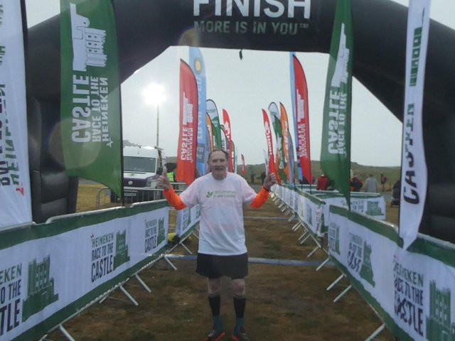 Gregory crossing the finish line.