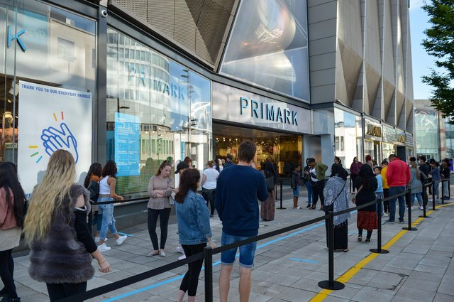 Shoppers queue at Primark in Birmingham as non-essential shops open in England